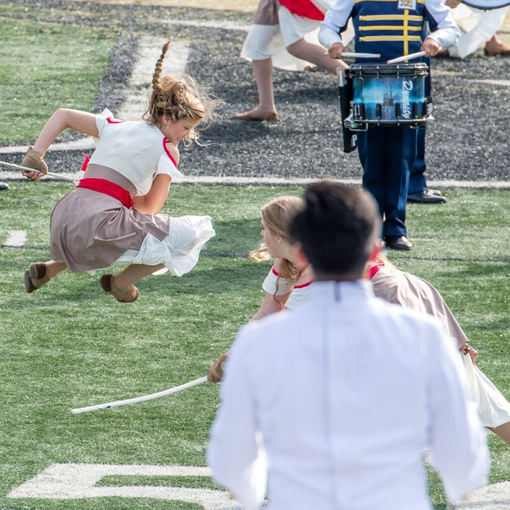 Naples High Band Performance Girl Jumping in Pirate Show