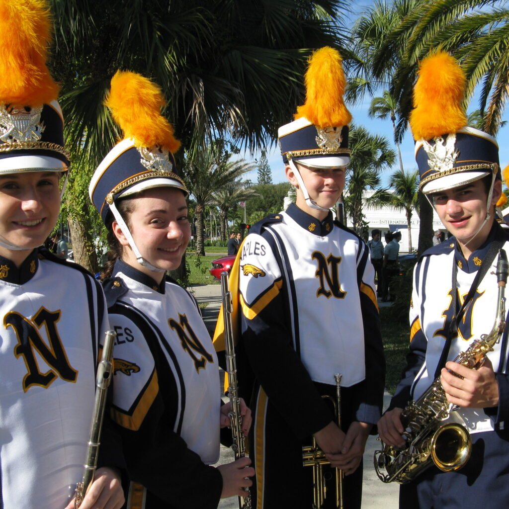 Naples High Band members posing before parade