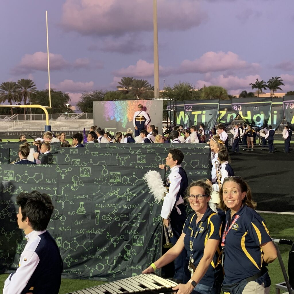 Naples High Band Heavy Metals Show set up featuring volunteers and band members