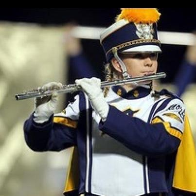 Naples High Band flute player in marching uniform